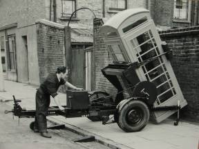 A worker installs a K6 phone box, London late 1930s.